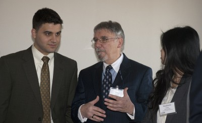 Dr. Michael Goupil, assistant dean of dental student affairs, talks with students during the Student Research Day Awards Banquet.