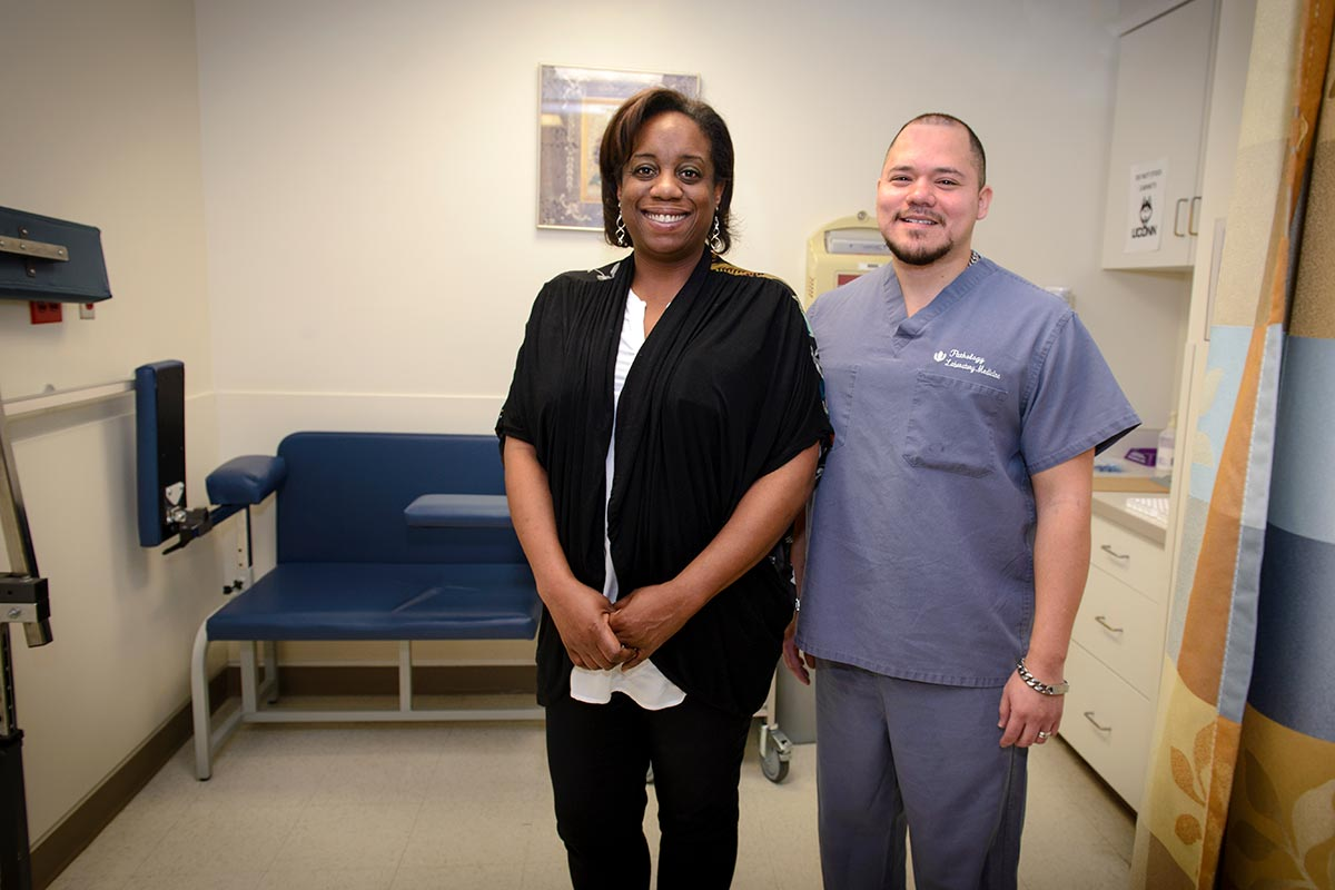 Latonya Robbs-Joseph and Juan Carlos Restrepo are credited with saving the life of an infant who had stopped breathing in the clinical lab Jan. 17. (Photo by Janine Gelineau)