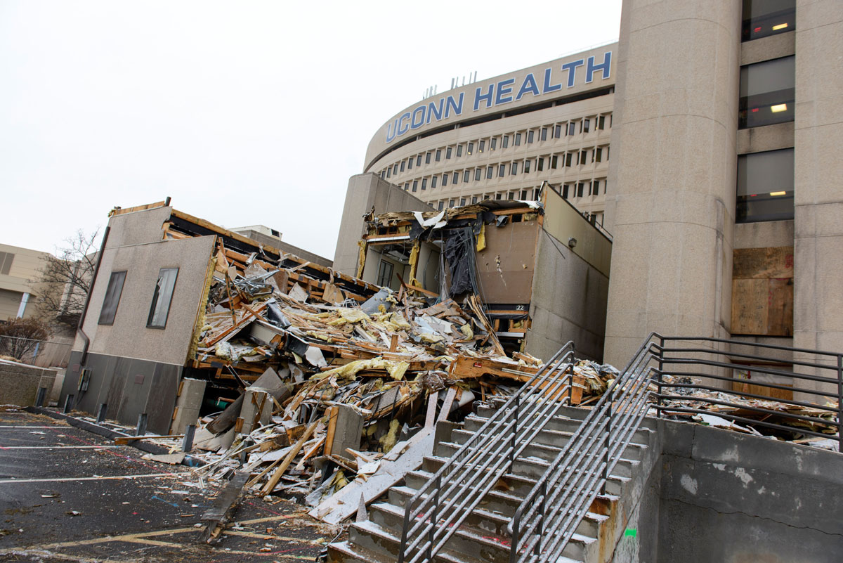 Building 20, constructed in 1990 for extra office space at UConn Health, in the process of being demolished. (Photo by Janine Gelineau)