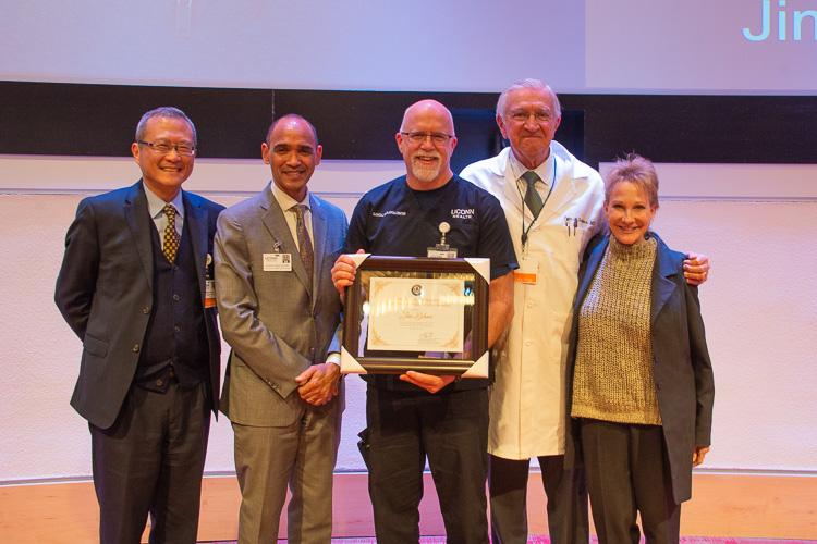 Jim Behme (center) winner of this year's Peter J. Deckers Award.